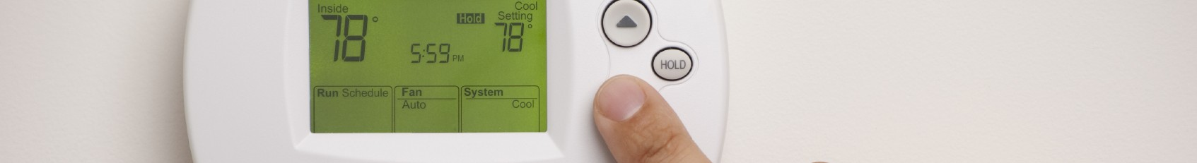 Digital Thermostat with a male hand, set to 78 degrees Fahrenheit. Saved with clipping path for thermostat and hand combined.